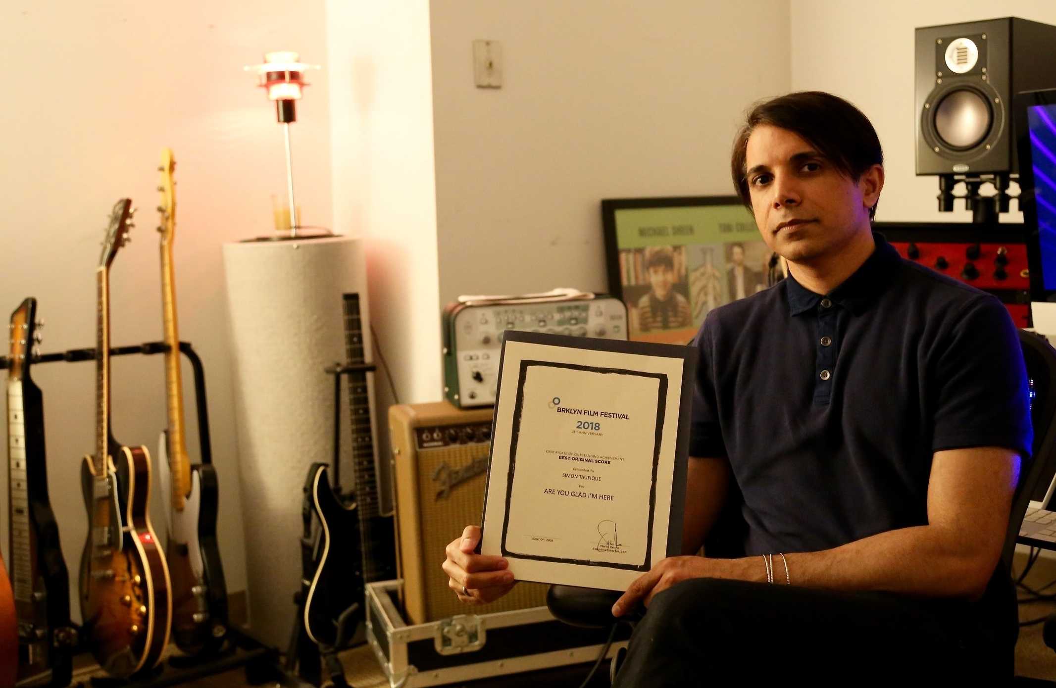 Are You Glad I'm Here wins Best Original Score and the Audience Award at the Brooklyn Film Festival - Composer Simon Taufique in his studio
