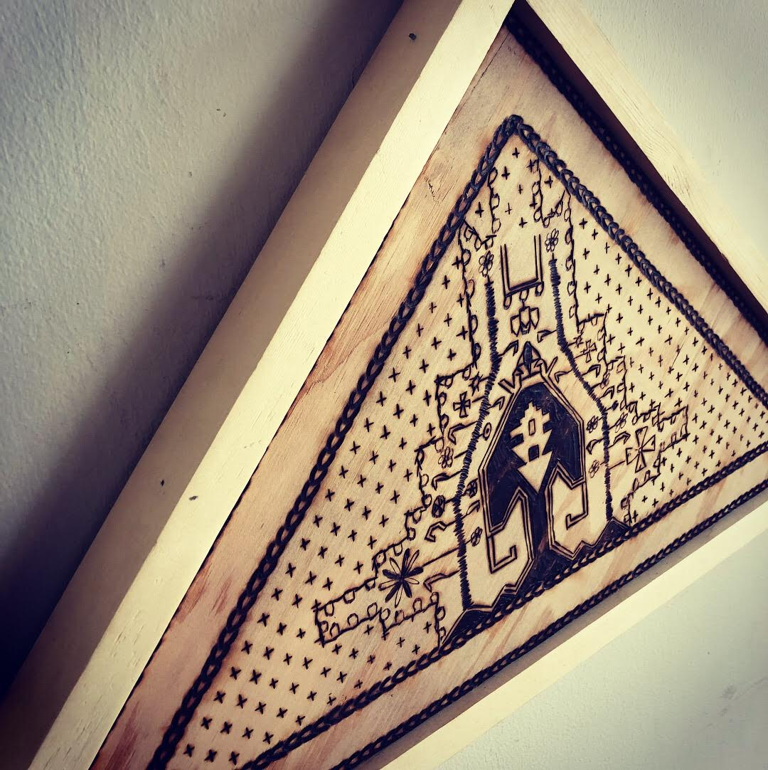Denny Bales is a local artist from the South Bay. He created this wooden textile piece with pyrography and used a Persian Hamadan rug from the 1960`s as a form of inspiration.