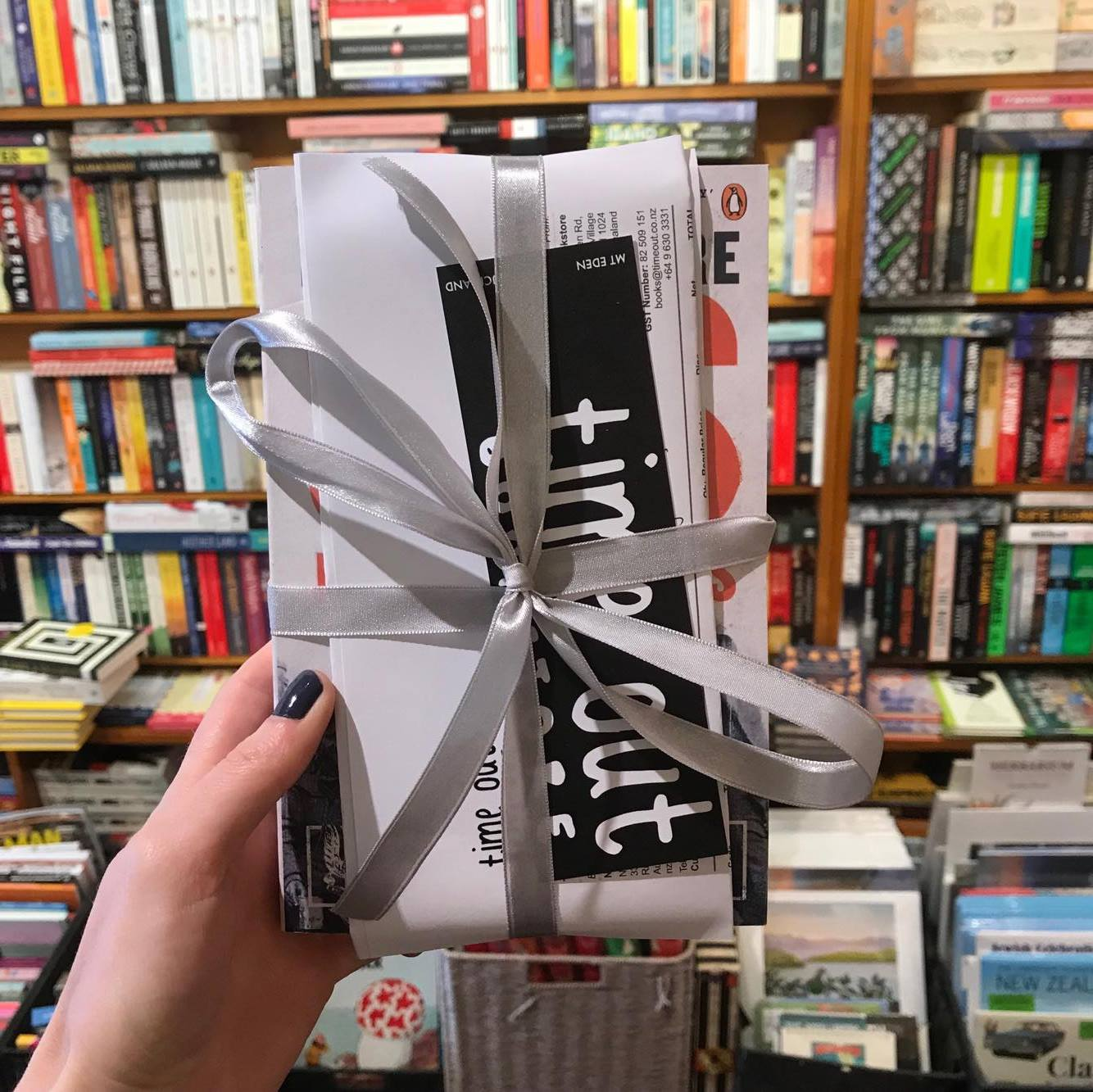 3. - We package your book up with your invoice, a bookmark and some ribbon...