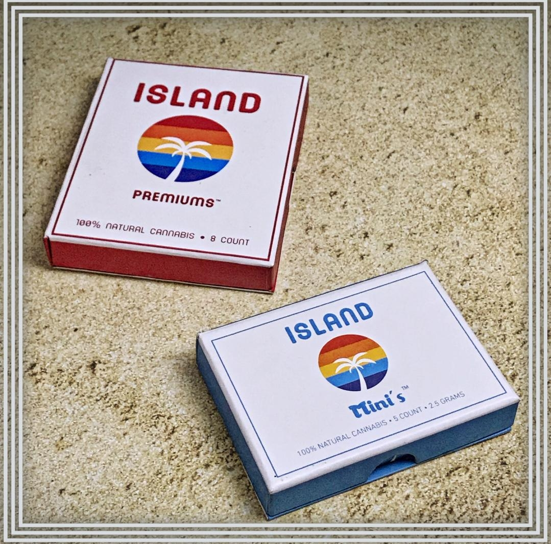 """Island Cannabis - Starting with the fun California vibe to the 100% natural flower, Island Cannabis is strain specific, lab tested for quality and safety, then hand packed into Mini's or Premiums preroll's and come in a convenient book fold box. Making everyday feel like a beach day.Mini'sIsland Mini's are made of Blue Dream flower (sativa dominate hybrid) and packed in 100% hemp paper. These classic mini's are perfect for a solo sesh, or even someone looking to smoke a """"j"""" for the first time, giving you as they say """"everything you want and all you need"""" and we could not agree more.Premium'sIsland Premium's are a perfect blend of old world smoking and modern cannabis. Made with Black Cherry (indica dominate hybrid), these filtered hemp tubes are light, smooth, and easy to smoke anytime your looking to unwind and relax. We think this is definitely one smoking experience everyone could and should enjoy.Nick and Lyna ThompsonLearn more islandcannibisco.com"""