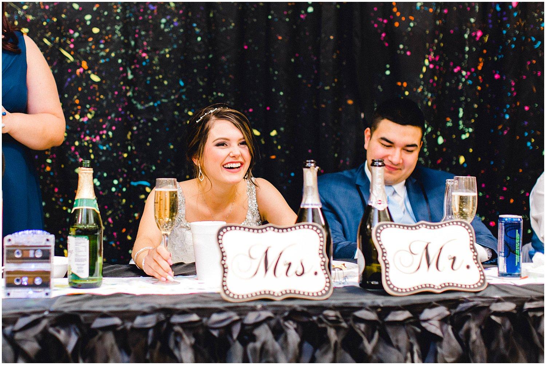 Hutchinson Kansas Wedding, Kansas Wedding Photographer, Wichita Wedding Photographer, church wedding, traditional wedding, catholic wedding, themed wedding, wedding photography, wedding inspiration, unique wedding photos, 80s themed reception, toasts