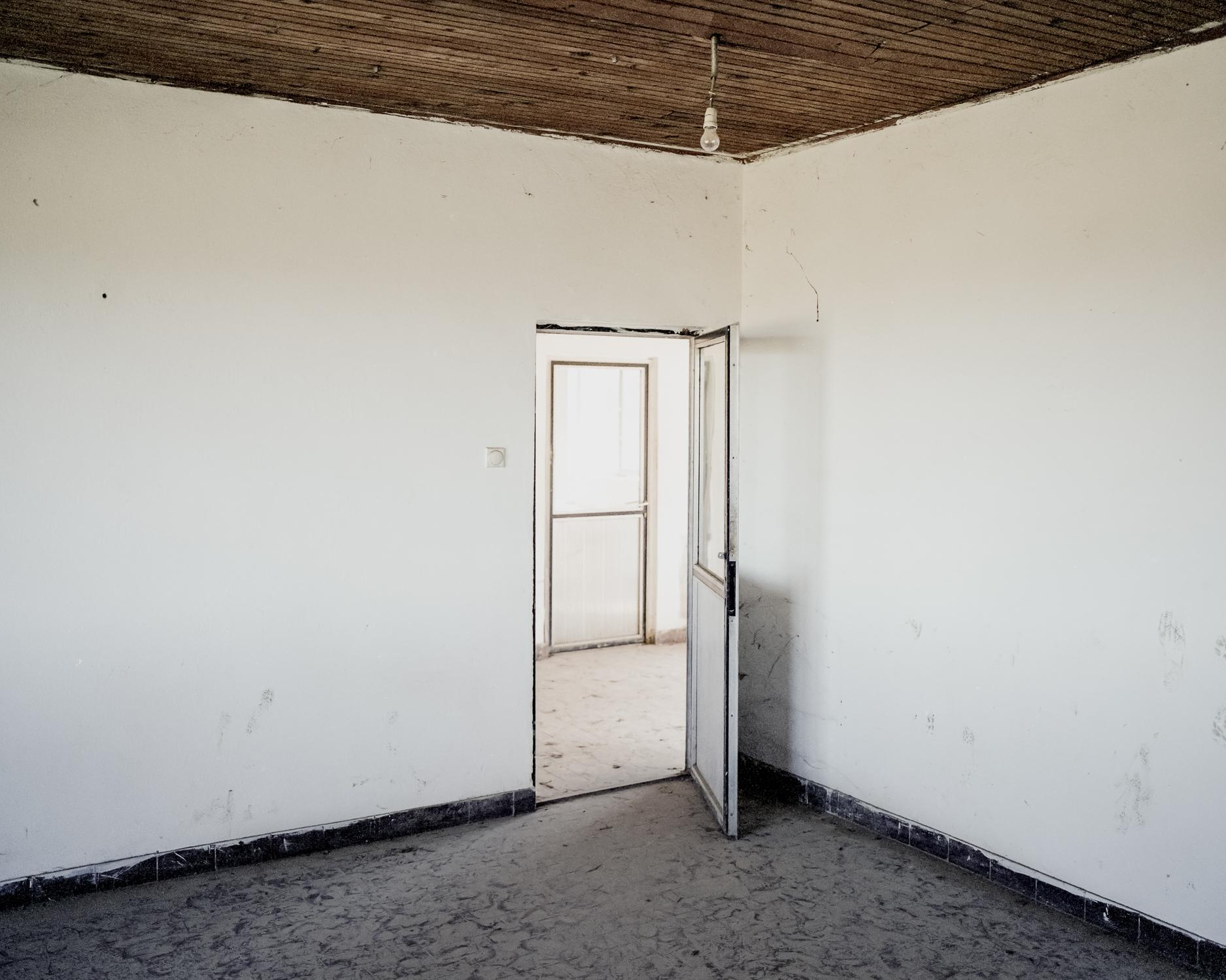 First room to the left, White House, Omarska, 2014 ©  Pawel Starzec