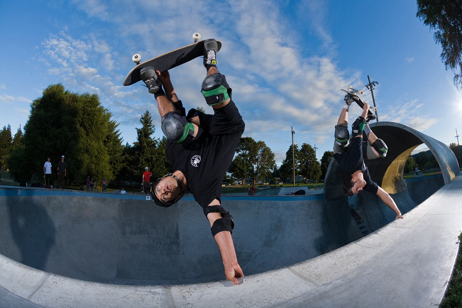 Mark Conahan and Steve Grover stand tall on a pair of handplants at Pier Park Skatepark.