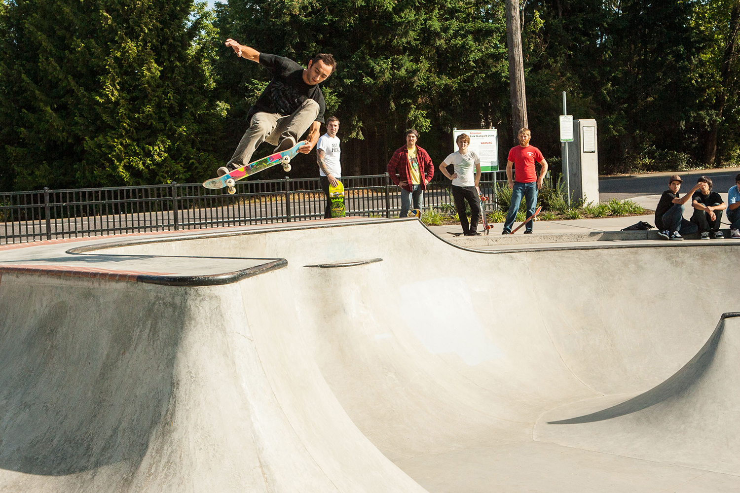 Professional skater Daniel Cardone floats above the lip of the Holly Farm Skate Spot.