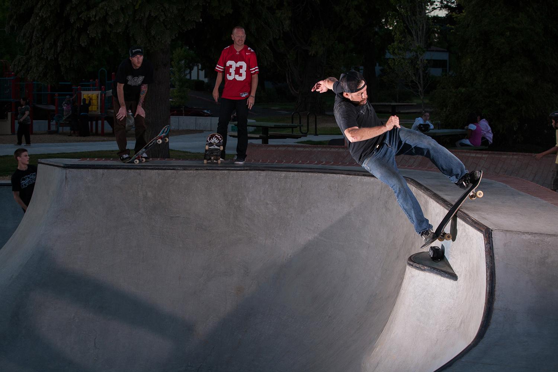 Ben Wixon lipslides frontside across the loveseat at the Holly Farm Skate Spot.