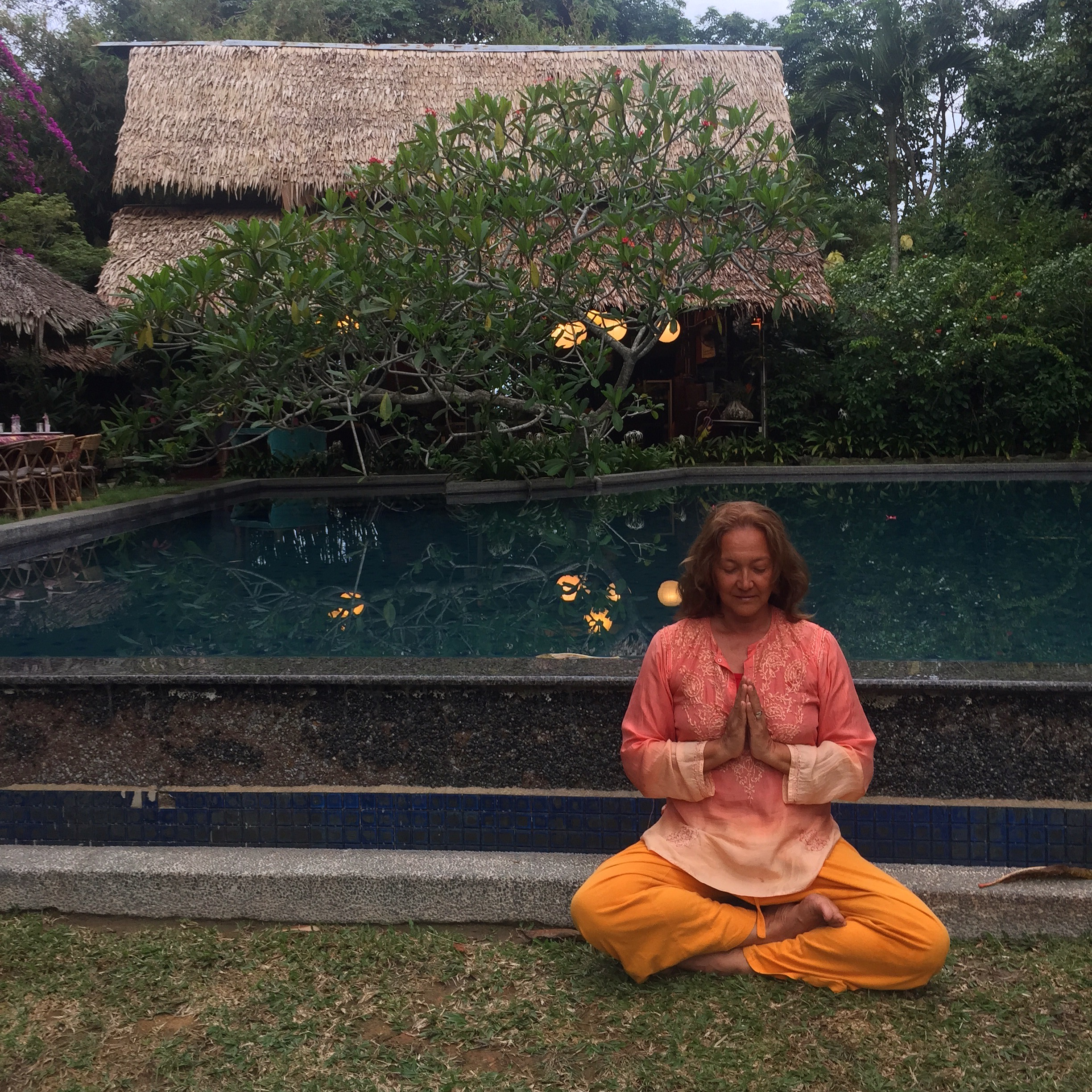 Yoga breathing practice at the end of the main pool at Tiger Rock. Open your eyes to a wonderful green jungle view.