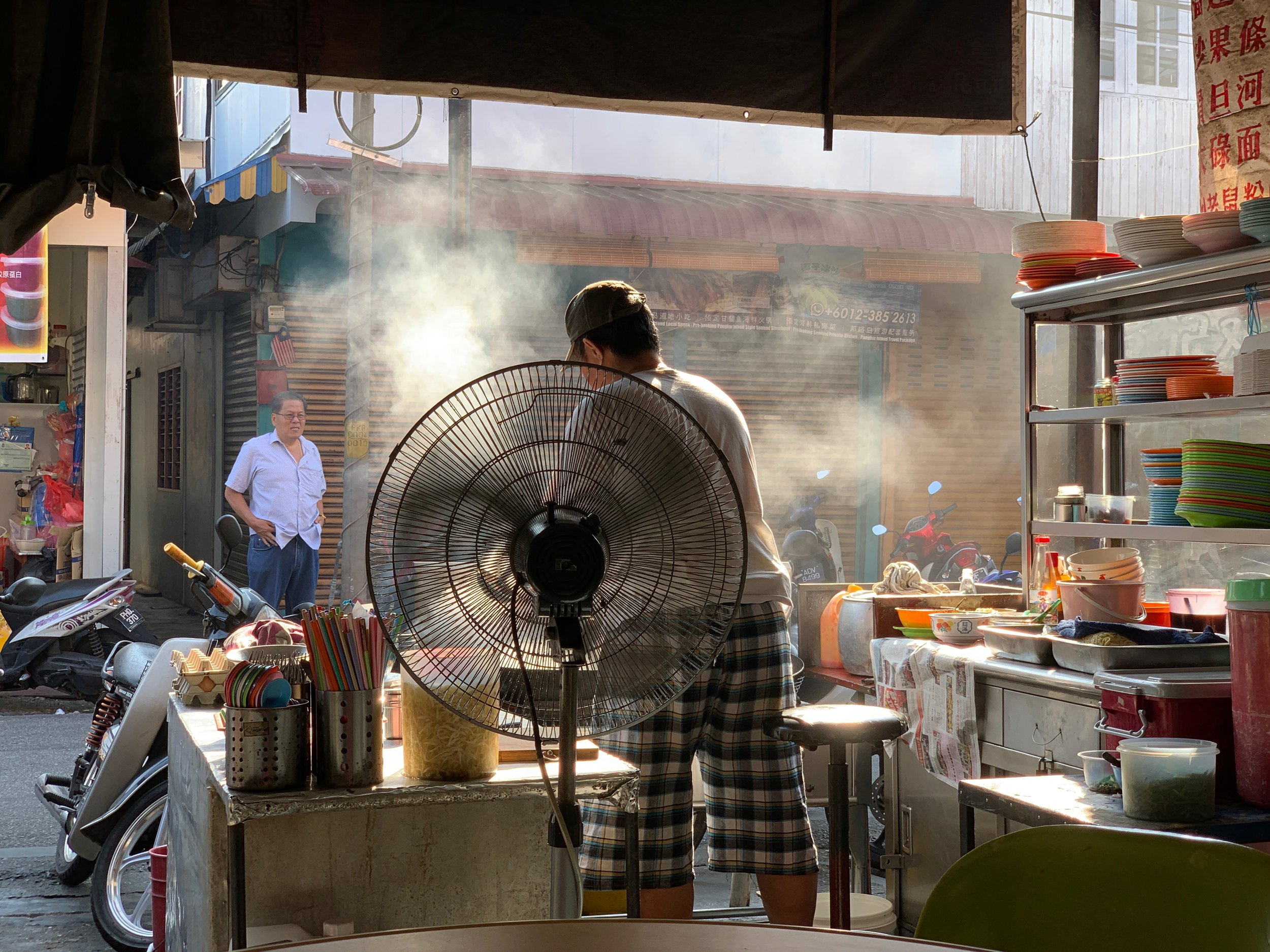Keeping cool while cooking at one of the breakfast food stalls