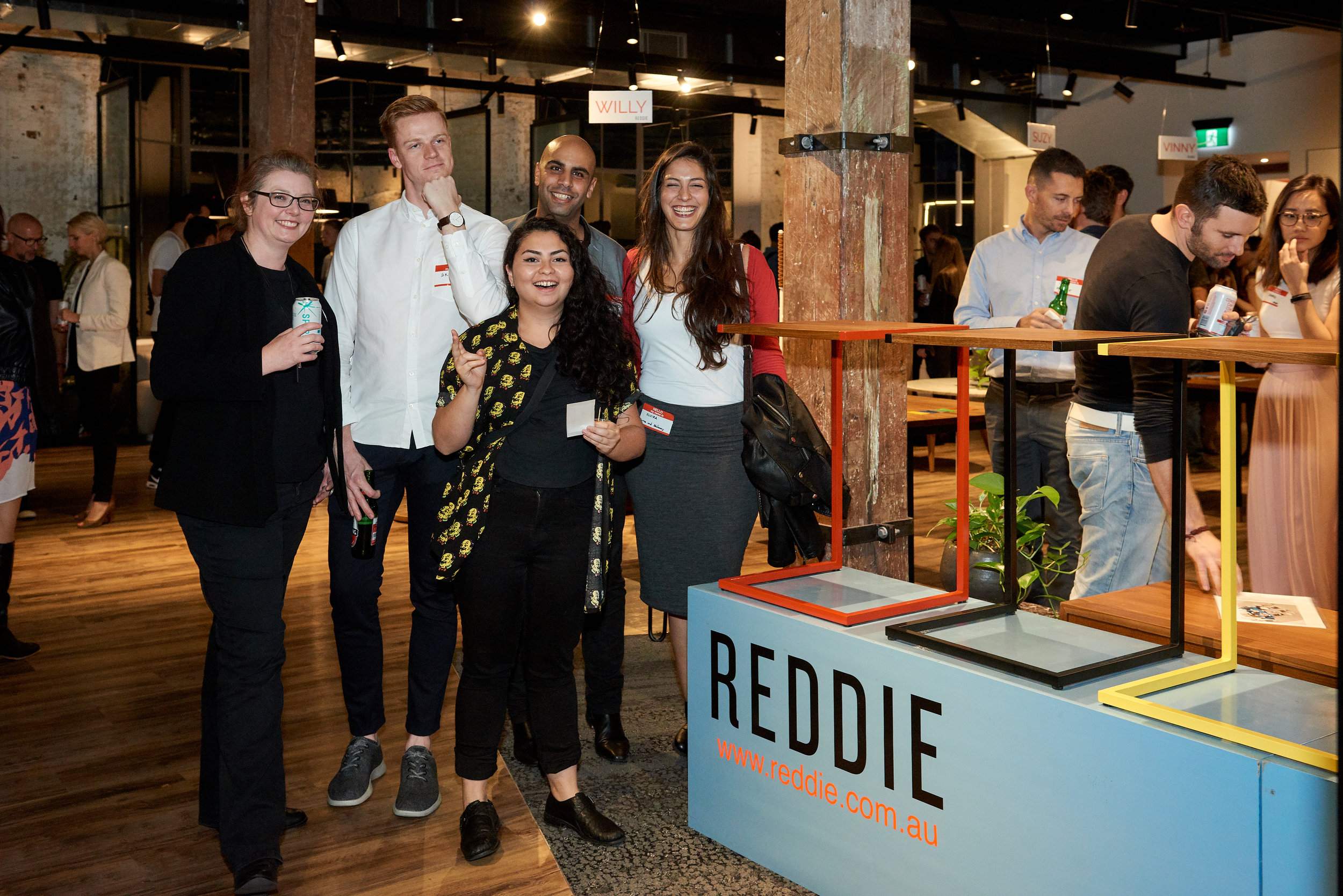 Happy guests gathering at the REDDIE sign amid the fun and celebration