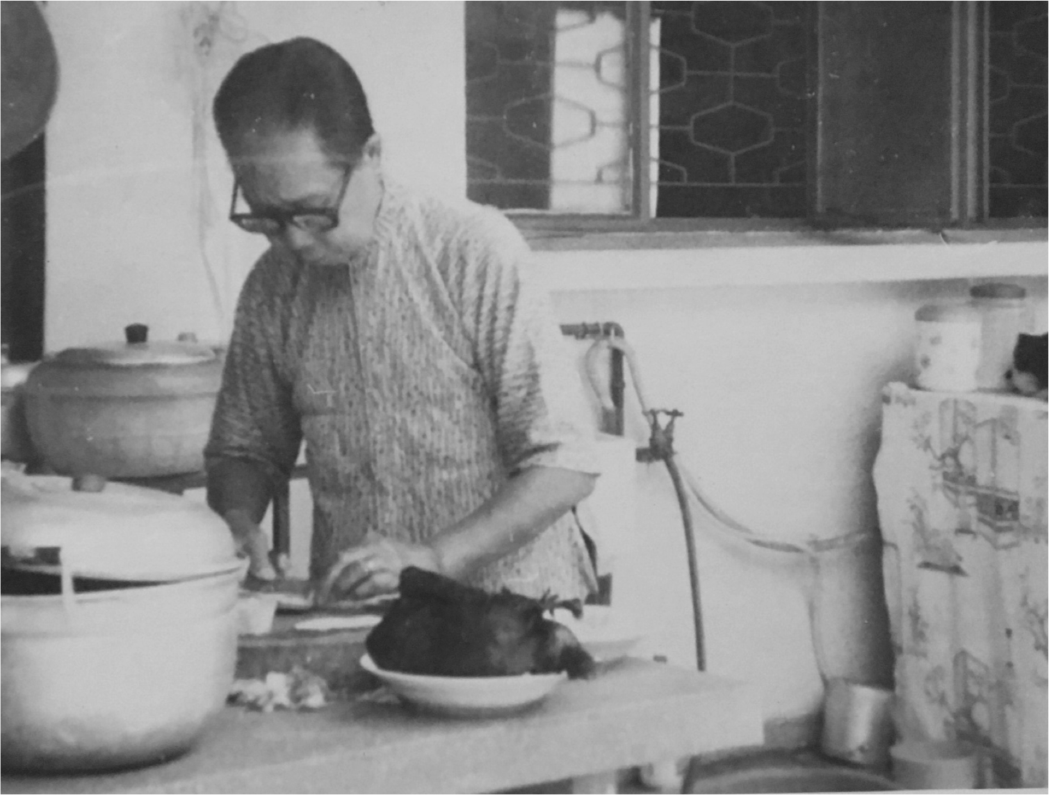 Auyong Foon preparing food in an outdoor kitchen
