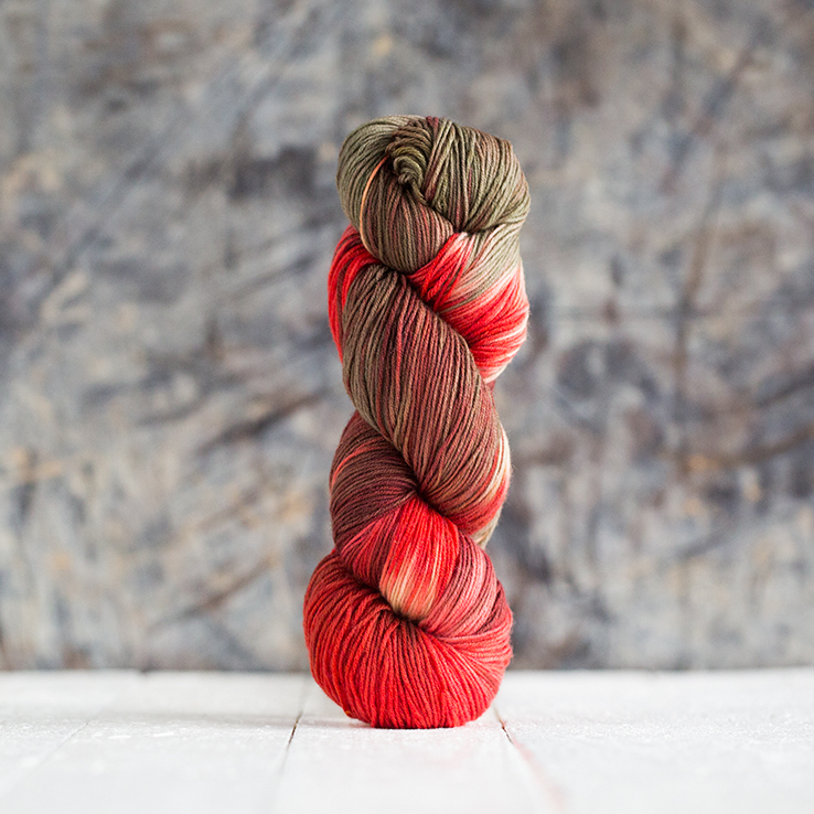 at bottom handyed wool by hand size fingering Merino yak and nylon shades of red Thoth 100g  400 m