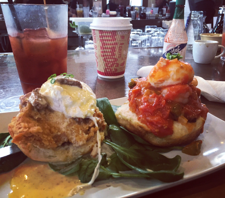 Eggs benedict topped with fried chicken on the left, shrimp creole on the right. Dayum.