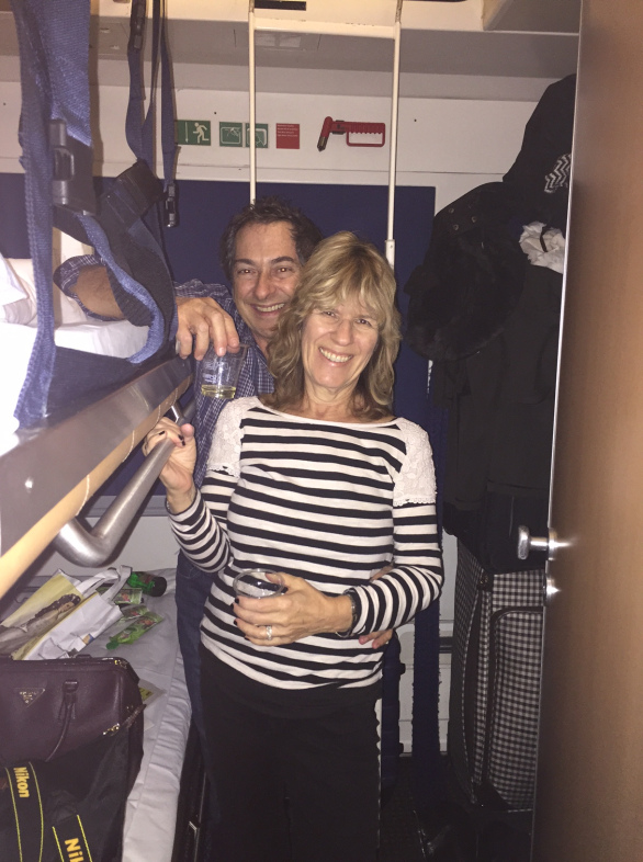 my parents + their prosecco in our teeny tiny steerage room
