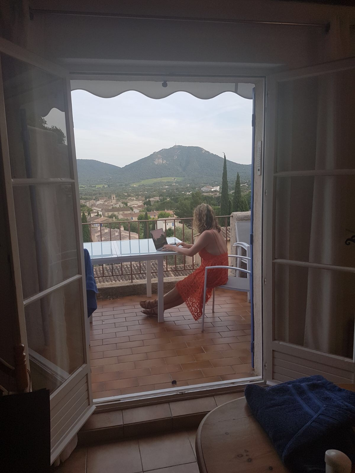 Me, writing book 4 while on holiday last week