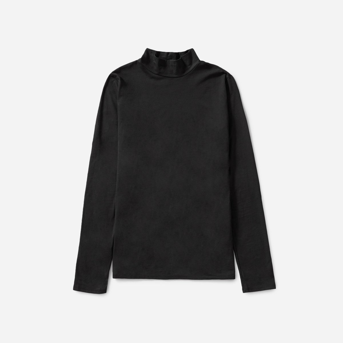 Classic Black Turtleneck - This is a must, especially if you travel often. Throwing on a black turtleneck will keep you warm and comfortable, and it looks chic.