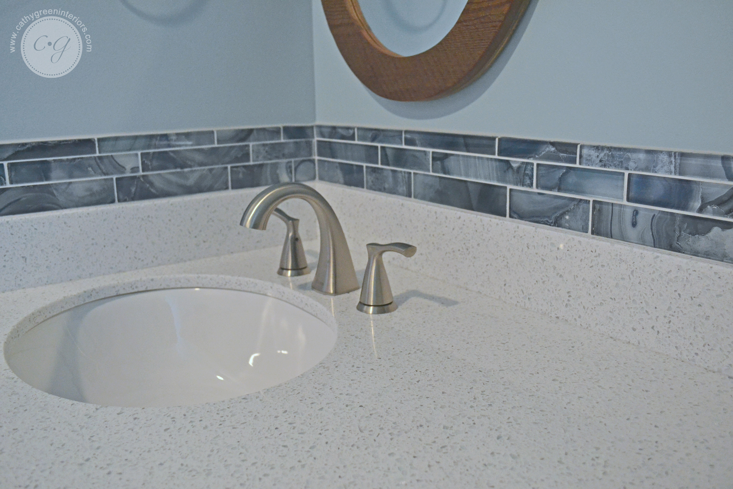 white quartz countertop & blue tile backsplash, bathroom countertop