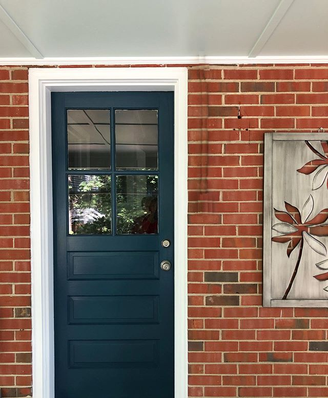 A few posts back, I shared the yellow front door of a client's exterior painting project. They loved the yellow color for the front door 💛🚪, but wanted a something softer for the side door and back door. So, we decided to go with the same color that we used on the shutters to help tie the spaces together. I love this color we landed on for their shutters and other doors - Sherwin Williams 6230 Rainstorm. It compliments the colors of the bricks, coordinates so well with the airy blue we chose for the porch ceiling, and it is neutral enough to allow for a different front door color if they ever want to change that.  Is it navy or dark teal, or maybe a bit of both!? Either way, it's perfect 😍! . . . #cgicolorstories #cgibonairexterior #bonairva #exteriordesign #exteriorpaintcolors #exteriorpainting #porchdecor #paintcolors @sherwinwilliams #sherwinwilliams #sherwinwilliamsrainstorm #bluedoor #screenedporch #screenedinporch