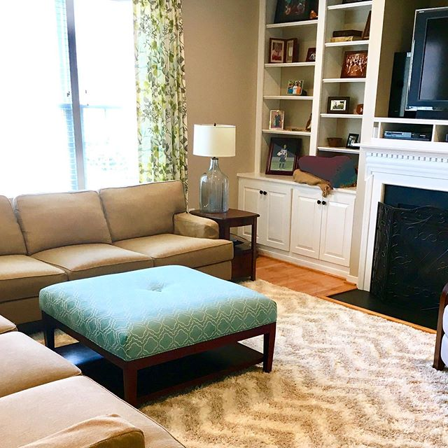 Not every room needs a complete make-over. For this project, my clients wanted to keep most of their furniture, but update the room in other ways. So, what did we do? 🤔  Swipe for the before picture and see if you can spot at least  5️⃣ differences between the before and after, then read below to see if you were right! . . . 1️⃣ New rug (pattern and texture add interest to the space) 2️⃣ Reupholstered ottoman - thanks @ufabstore ! (fun turquoise pattern) 3️⃣ New window treatments (a lighter color fabric brightens the space) 4️⃣ New lamps (bigger, but glass so they don't feel bulky) 5️⃣ New paint color (still neutral, but less yellow) 6️⃣ Decluttered bookshelves ( 7️⃣ New pillows - not pictured!) . How many did you get? . . . #cgiglenallenproject #cgicolorstories #glenallenva #shagrug #familyroomdecor #familyroomdesign #familyroommakeover #customwindowtreatments #turquoiseottoman