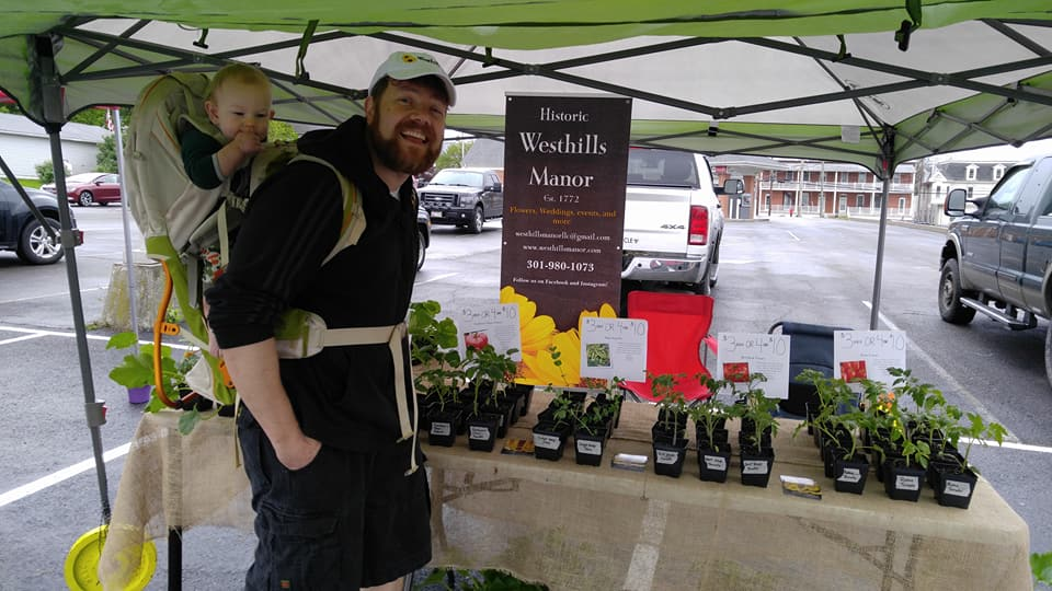 Jeremy and baby Wesley are hard at work at the Myersville Farmers Market selling garden transplants.