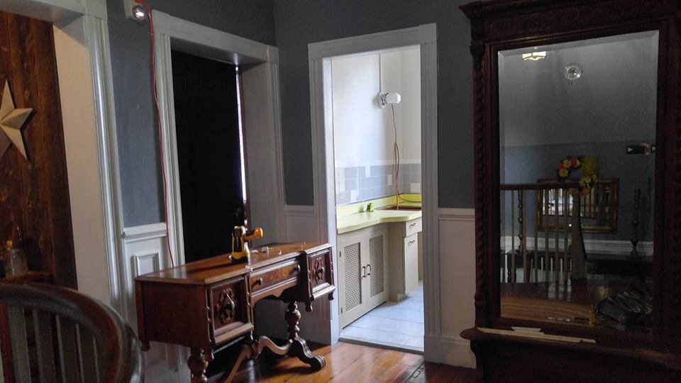 The entrance into the hall bathroom with the sink-less vanity. The desk that would become the future vanity is in the foreground.