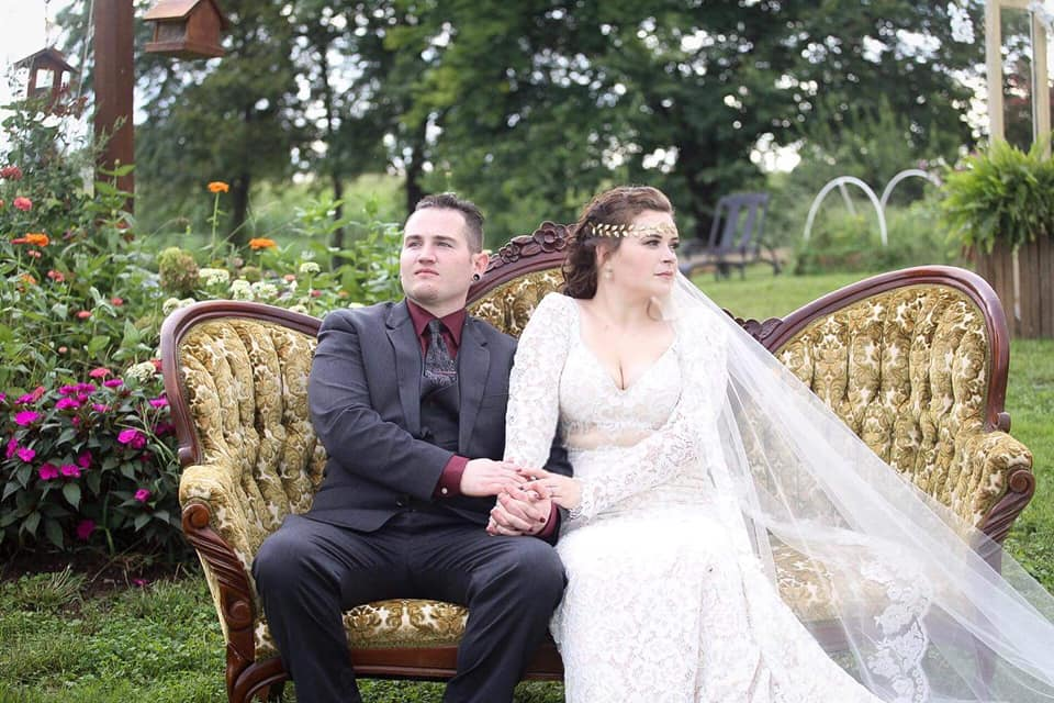 A breathtaking portrait of the newly weds using one of the Manor provided antique camelback couches