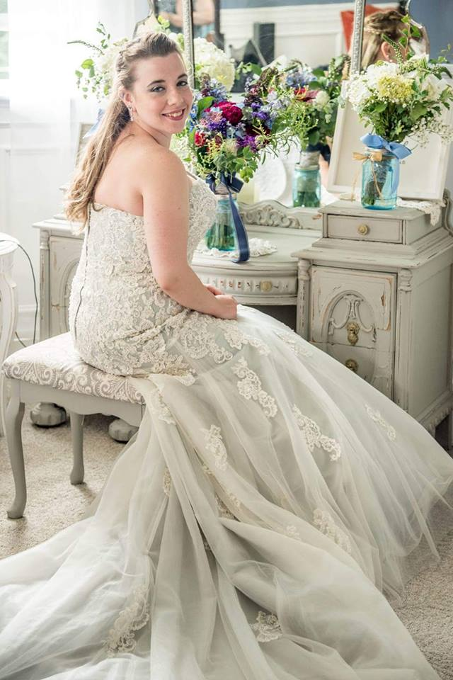 Our glowing bride finishes getting ready in the bridal suite