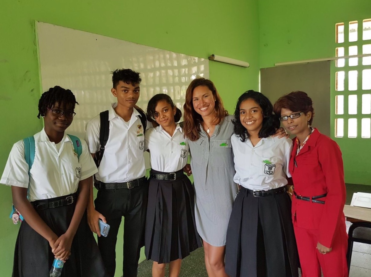 A few of the student members of C.O.R.E. and Geography teacher, Sunita Maharaj.