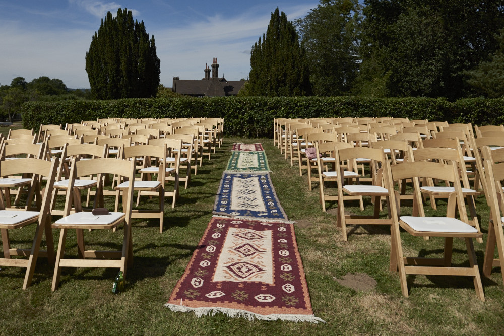 DIY wedding aisle with Persian rugs