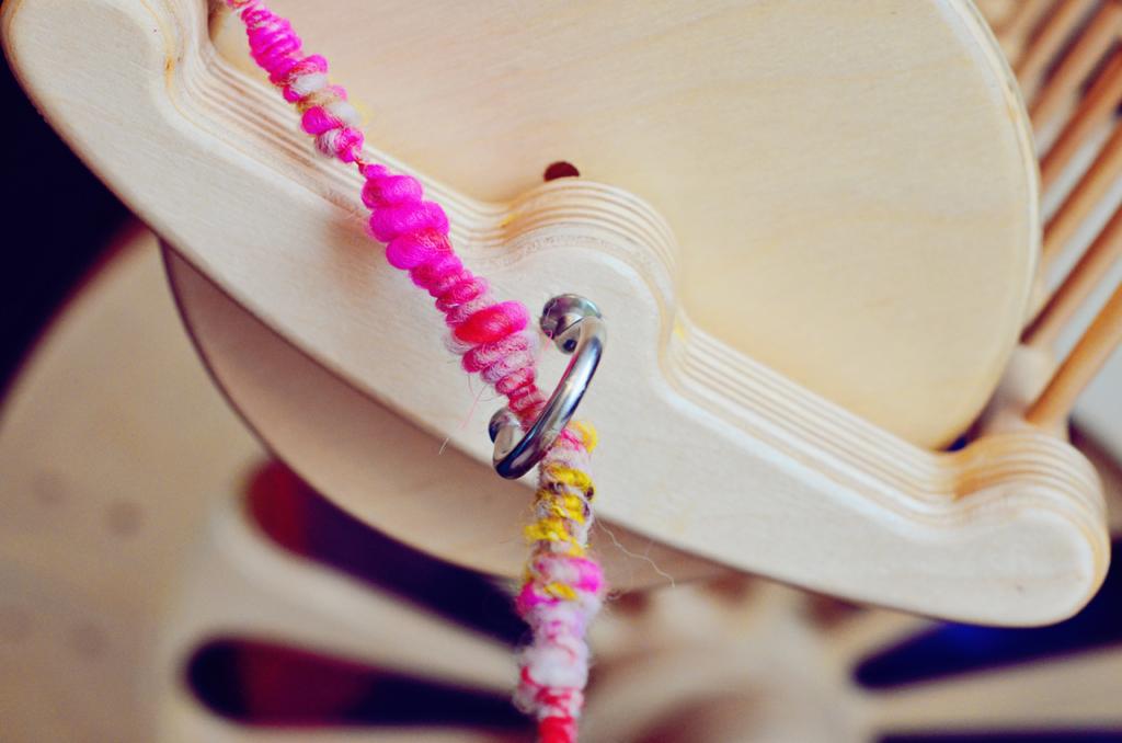 Art Yarn Coils on a Spinolution Mach III Spinning Wheel