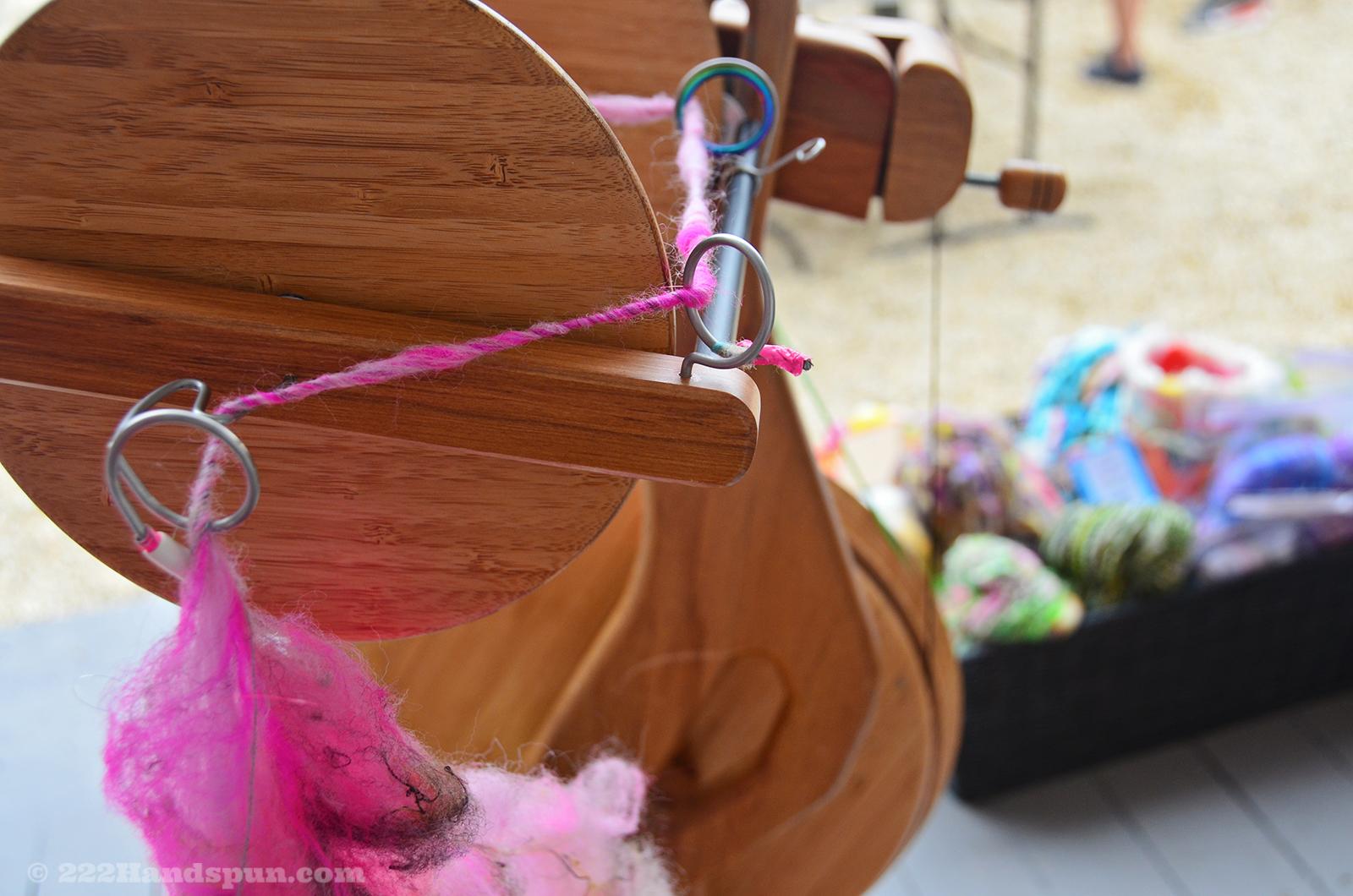 Me spinning corespun art yarn on my Majacraft Aura wheel