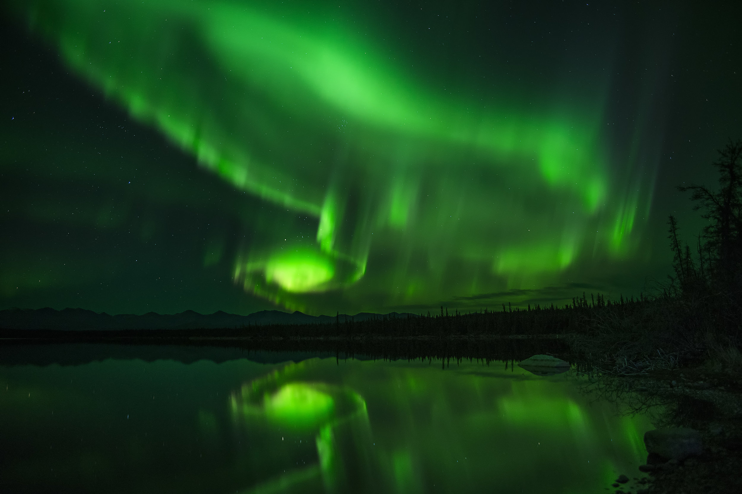 Northern Lights or Aurora Yukon over a lake Chris Pepper
