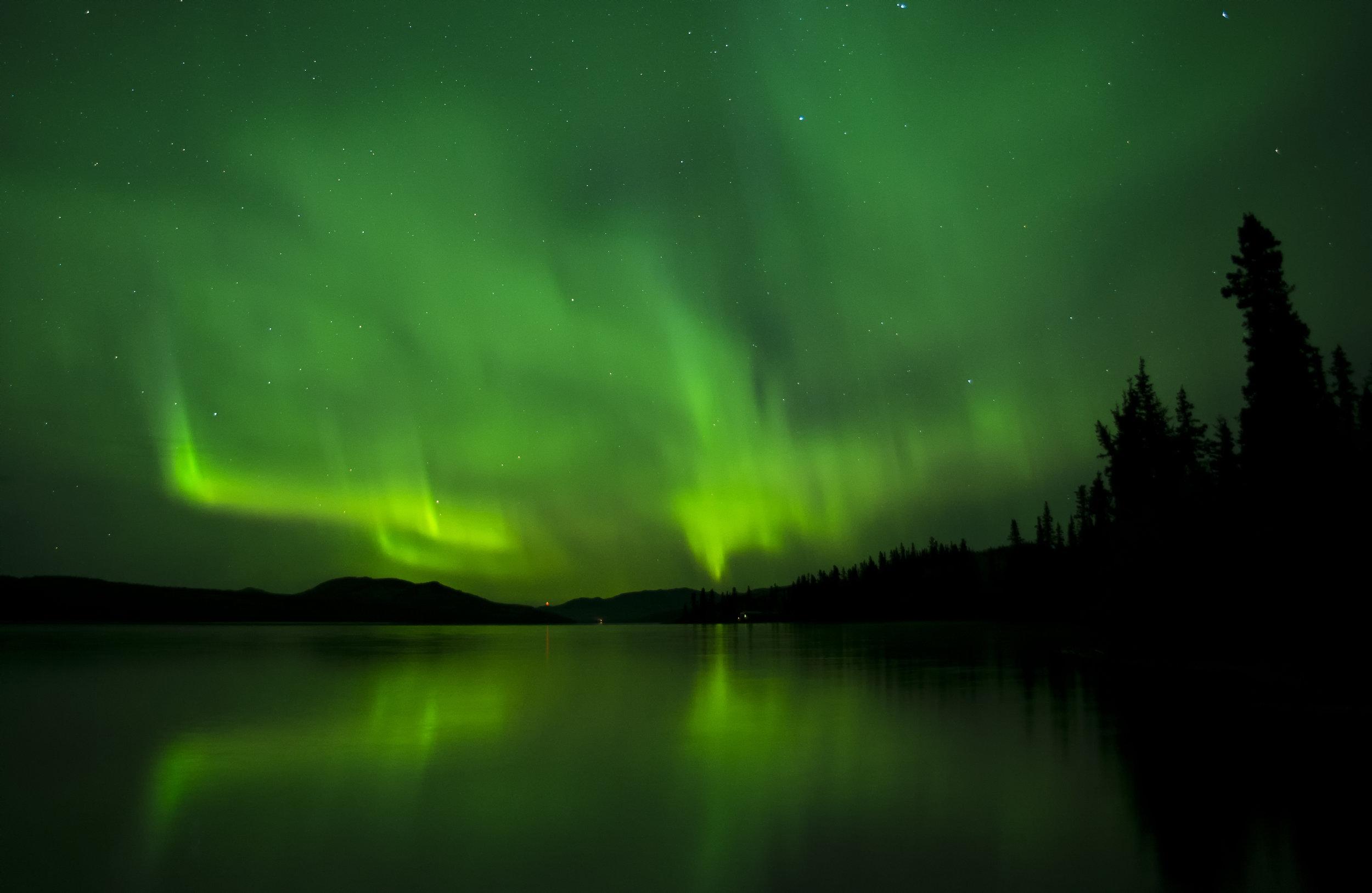 cloudy aurora in Canada