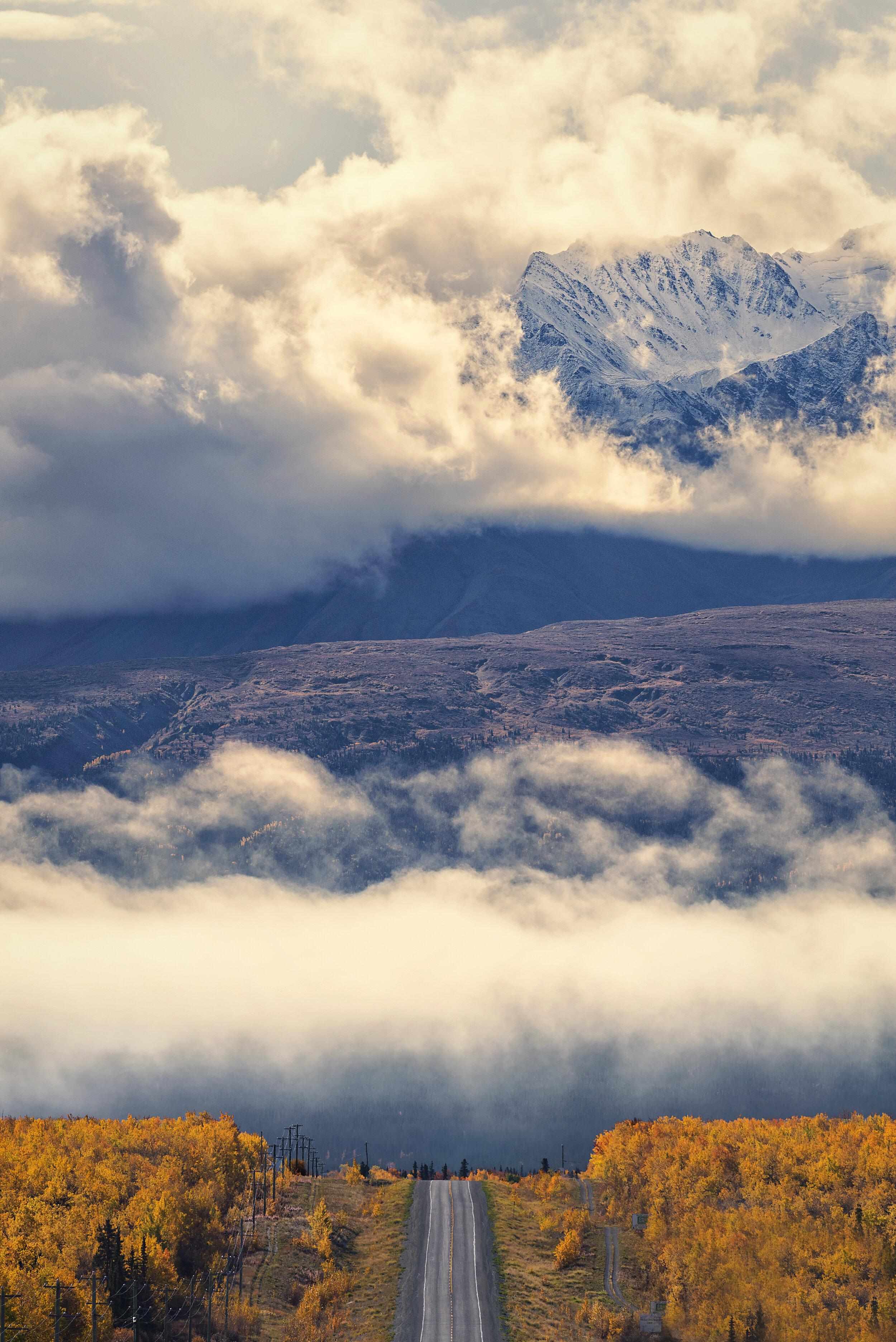 Fall colours, fog and Yukon mountains