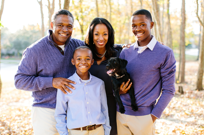 African American Family with puppy own photo Stocksy_txp44a1f513KWL000_Small_471264.jpg