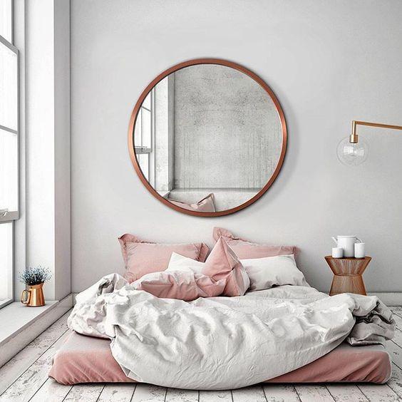 big round mirror above bed.jpg