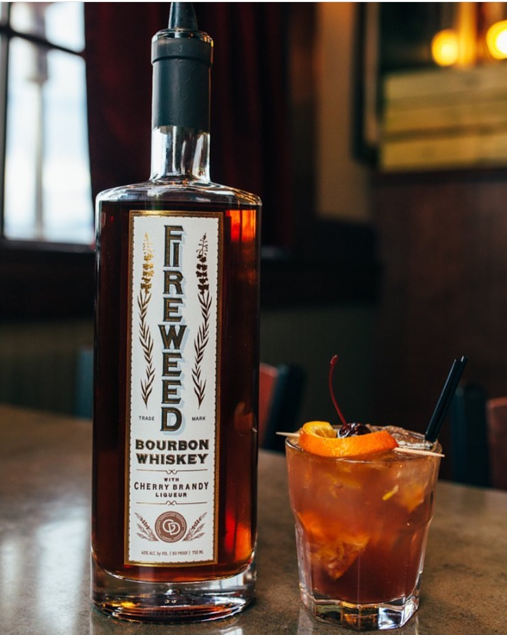 Fireweed Old Fashioned - In a rocks glass:Muddle orange wedge with teaspoon of brown sugar and two cherries (we usehouse whiskey-soaked cherries)Add small scoop of ice2 oz. FireweedAdd splash of sparkling water, if desiredTop with 5 drops aromatic bitters