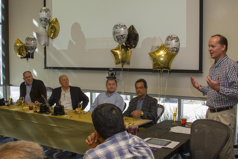 CEI Executive Director Jeff Saville celebrates the ECM team and the incubator company's achievement of one million dollars in revenue