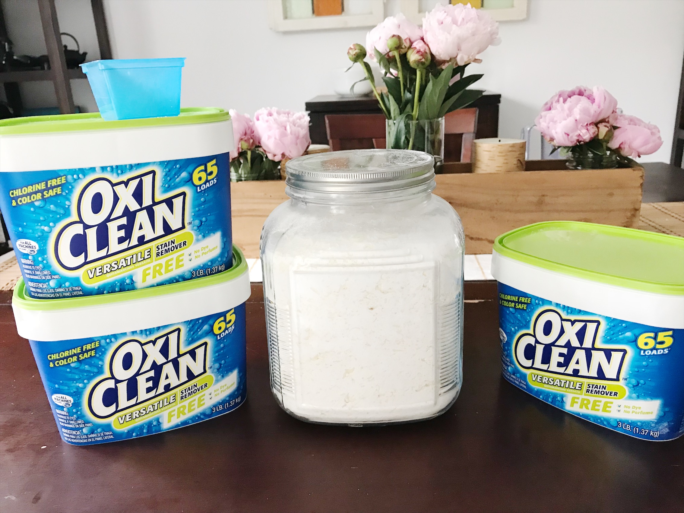 Step 4 - Store all the detergent in containers--I use the previously emptied out Oxi Clean containers and a large glass container. Voila! Cheap, easy and