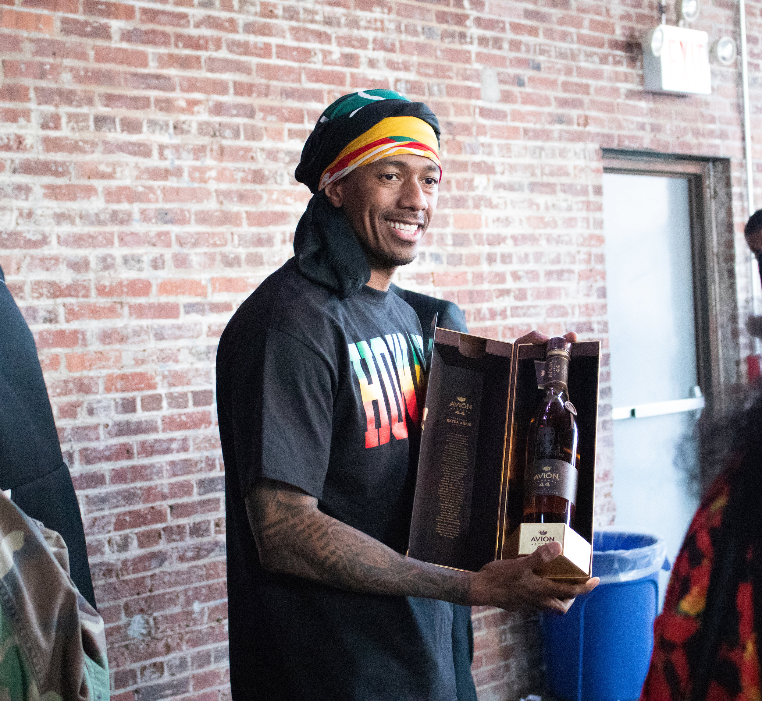 Nick Cannon receives a gift from 2018 Culture Con sponsor, Avion Tequila, before stepping on the CC stage.