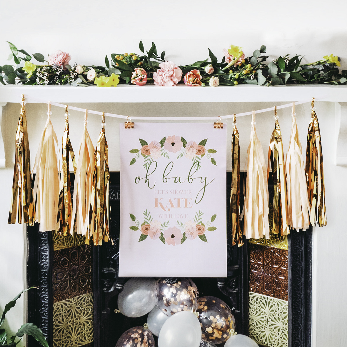 We hung a posters onto a length of ribbon using binder clips and used tassels from our tassel garlands at either side.