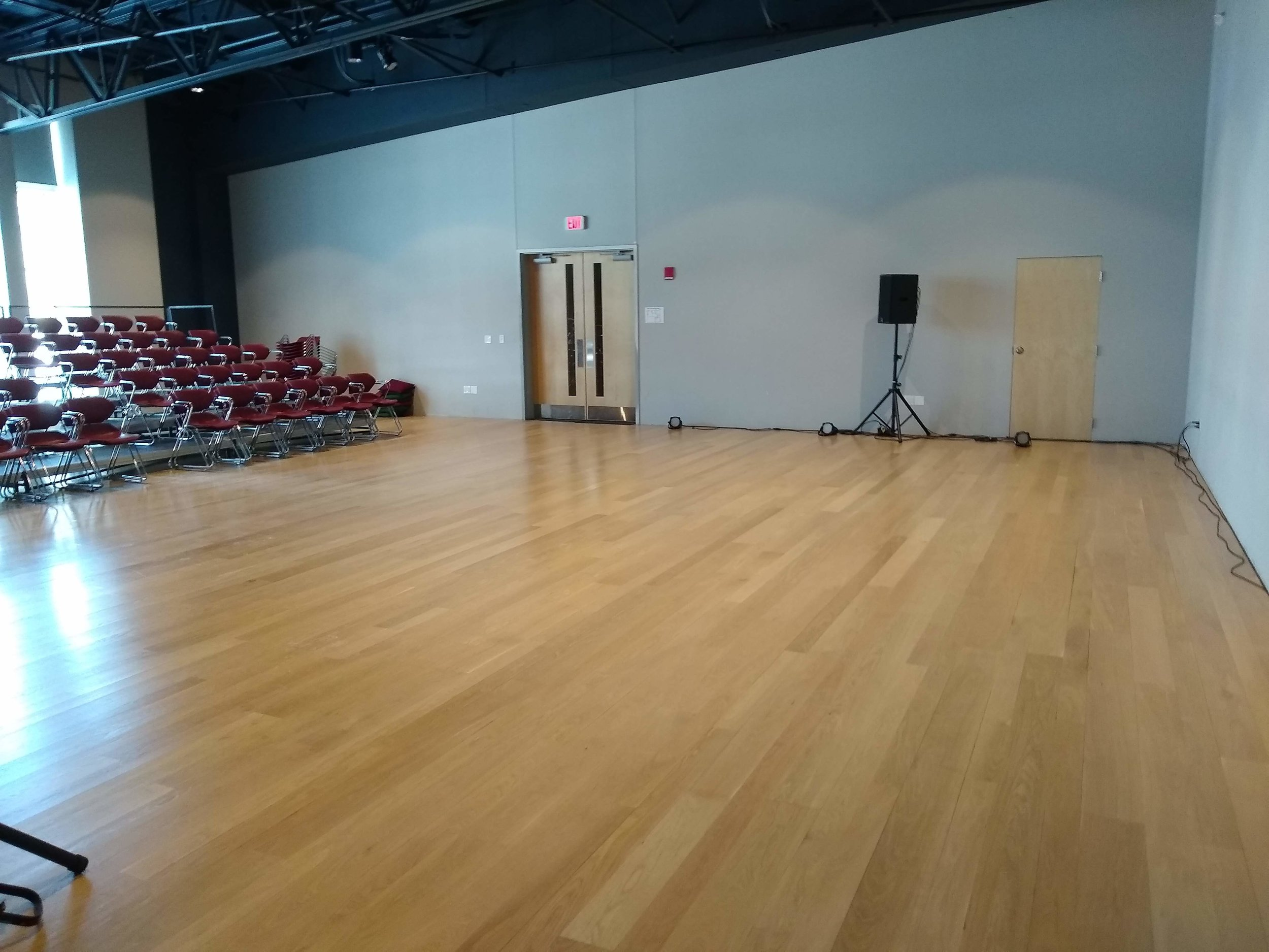 This photo shows the Flex space with risers and chairs in front of the windows. Riser can also face the wall opposite the doors, or be removed entirely, depending upon the needs of the event or performance.