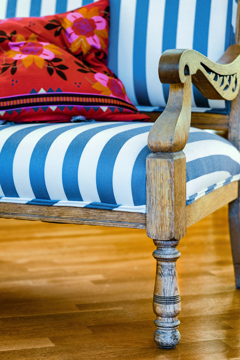 Antique settee  Design Thought:  A re-fashioned antique saves wood. By merely changing fabric, it can make something old look new again. When selecting fabrics consider those that are a renewable resource, such as a plant or protein fiber or even a recycled synthetic.