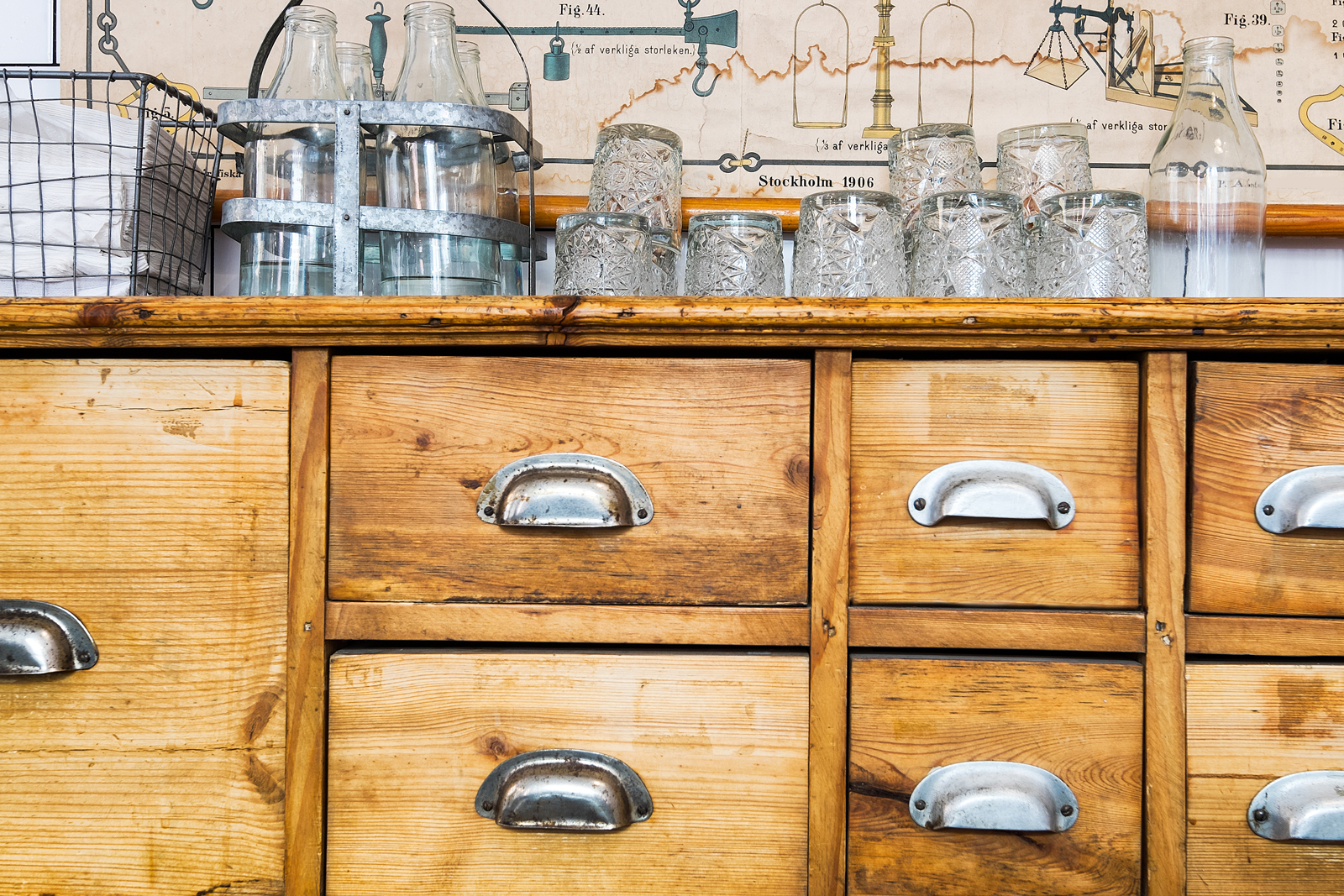 Reclaimed Apothecary Sideboard  Design Thought: Any beautiful piece of reclaimed furniture can find a place in a design plan. This apothecary sideboard has been repurposed for used as an island in the kitchen.