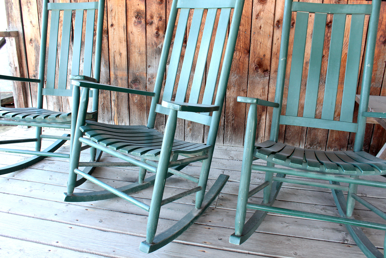 Turquoise Rocking Chairs  Design Thought:  Re-fashion old rocking chairs by painting them a new color.  Save a tree.