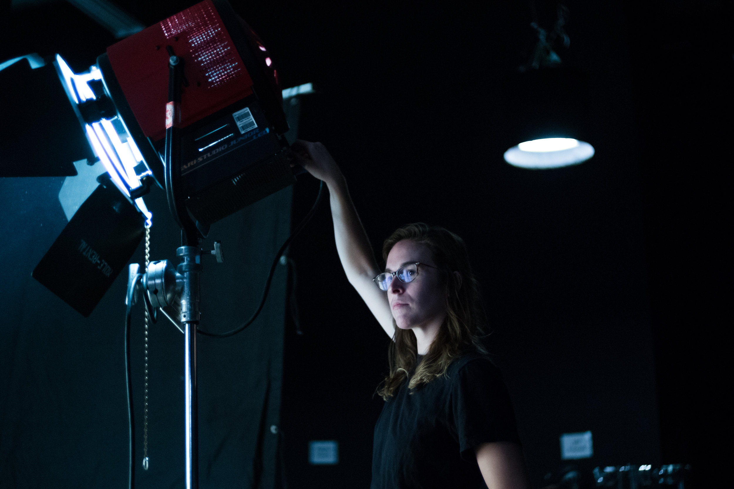 Cinematography fellow Erin Hughes adjusts the lights at our cinematography workshop.