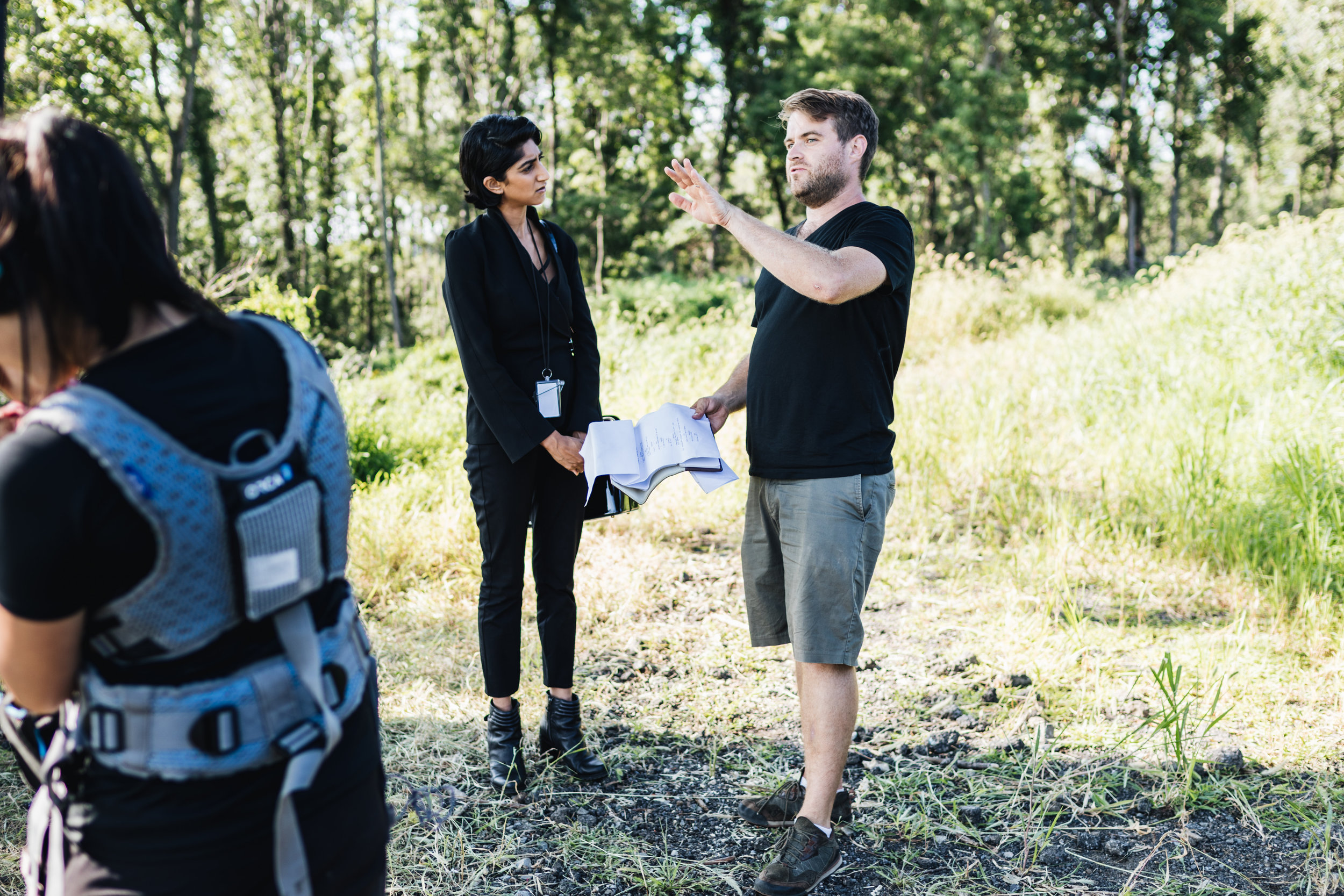 Moving Picture Institute fellow Ryan Patch gives scene directions to lead actress Sunita Mani ( GLOW ) on set of our newest original short film,  Regulation .