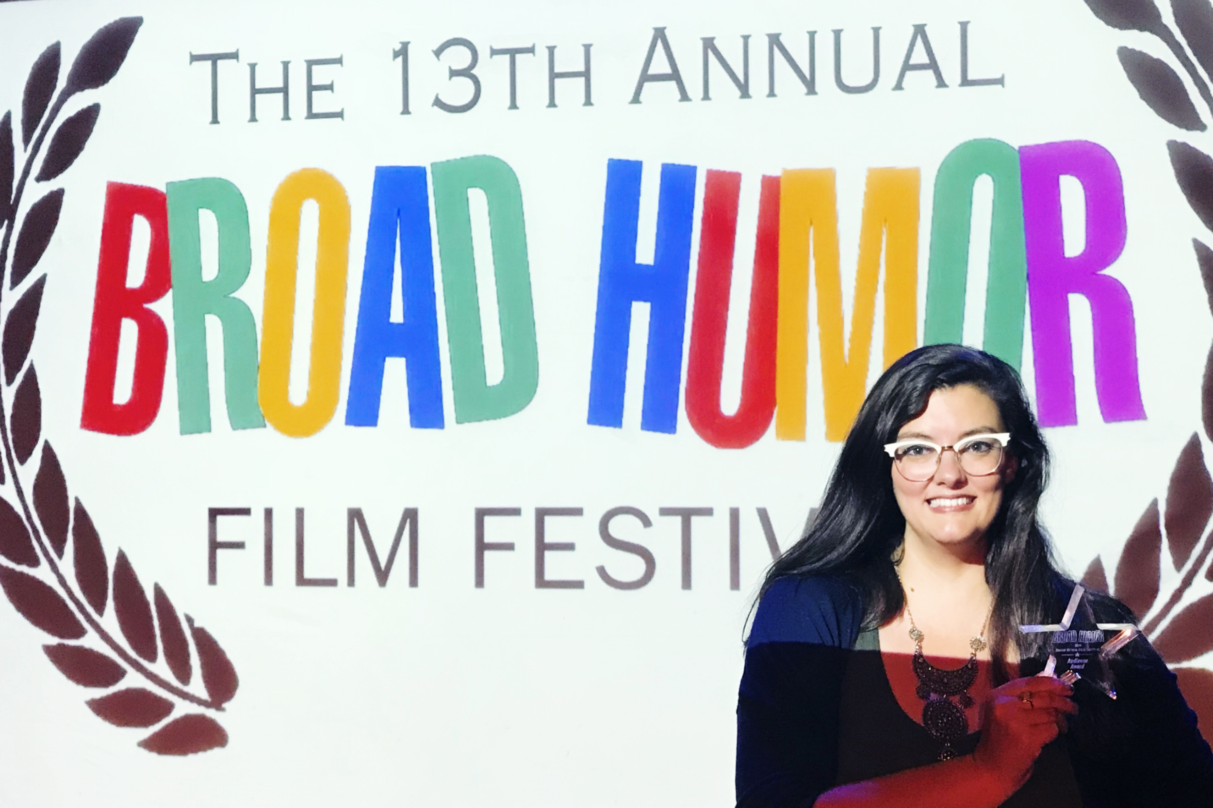 The Moving Picture Institute's vice president of talent development, Lana Link, accepts the Audience Award for MPI original film  Gringa  at the Broad Humor Film Festival.