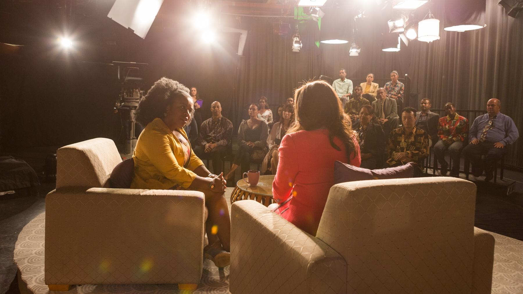 Talk show host Sally Rae (Vanessa Williams) blindsides Virginia (Uzo Aduba) during an interview.
