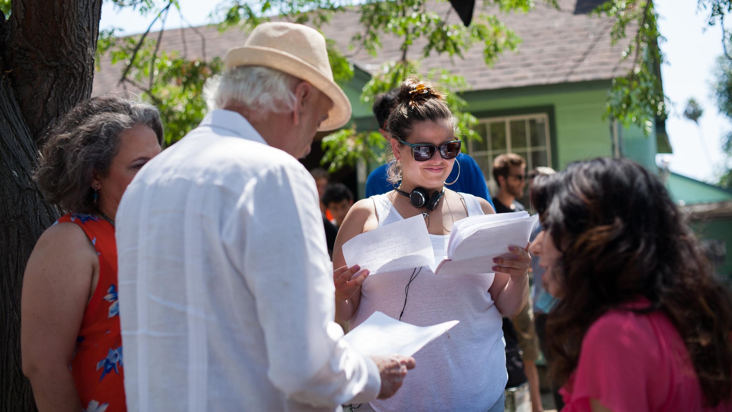 "Director Claudia Murray gives script notes to actors Lidia Porto (""Abuela""), Ruben Rabasa (""Abuelo""), and Anna Cecilia (""Vanessa"")."