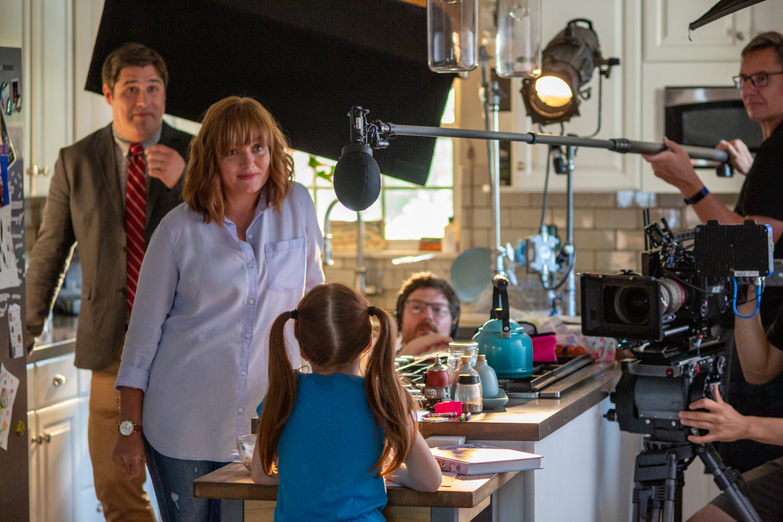 The crew shoots a family scene around the kitchen.