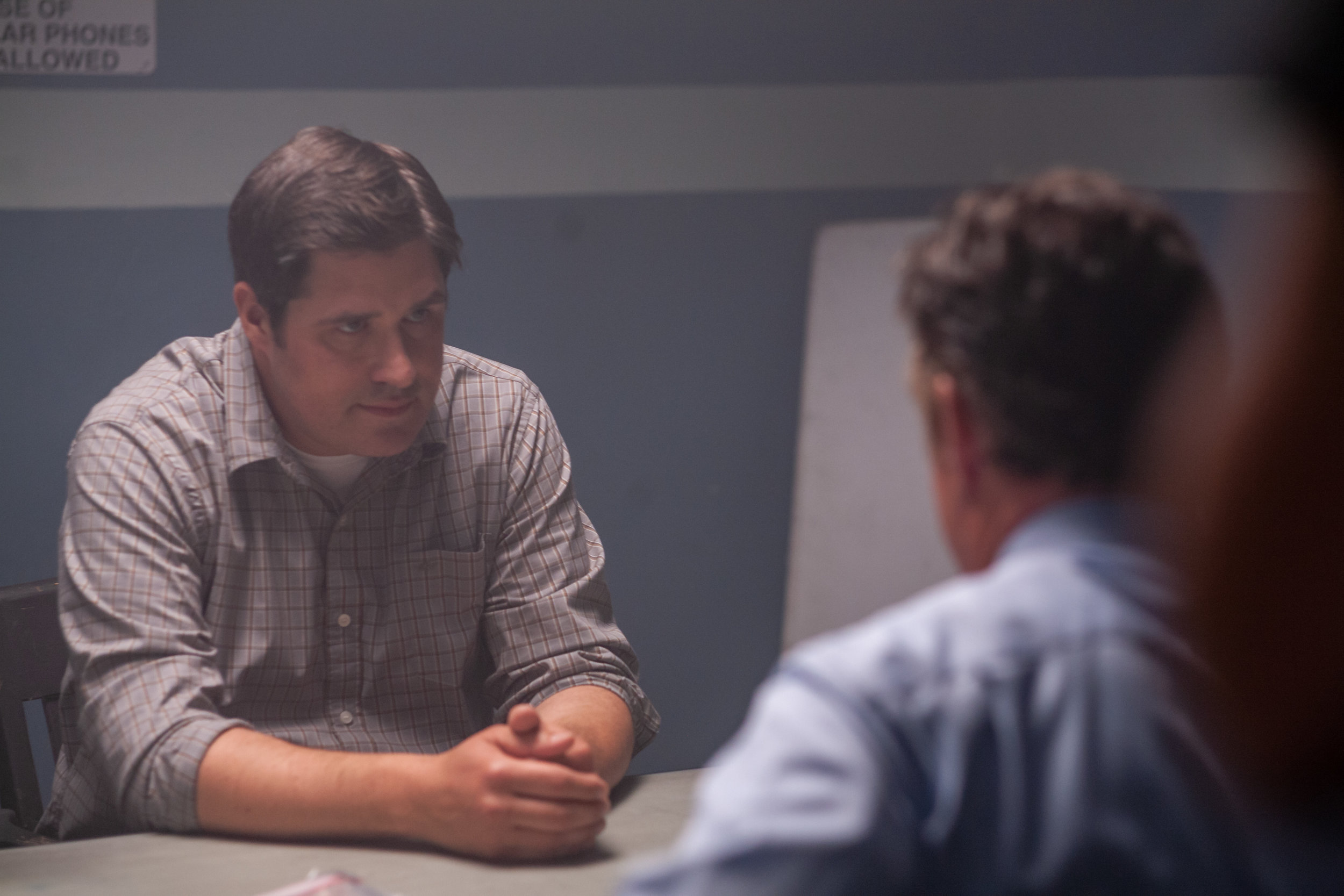 Actor Rich Sommer ( Mad Men ) performs a tense scene in an interrogation room.